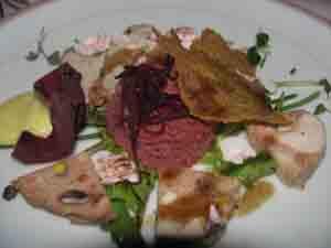 Galantina di pollastra e tacchinella marinata con spuma cotta di barbabietola.